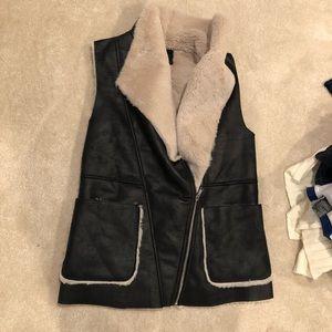 Fur lined black faux leather vest